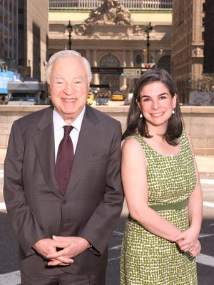 Arthur Frommer, left, and his daughter, Pauline Frommer, are photographed on Park Avenue in New York on April 23, 2007.  (AP Photo/Jim Cooper)