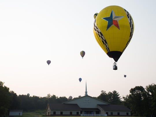 Balloons fload over Faith Baptist Church to try to hit their first target of the challenge on Saturday morning.