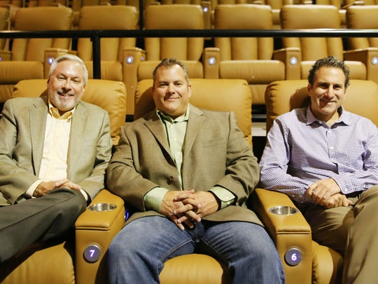 Owners of the Emagine Entertainment, Paul Glantz, left, managing partner and Jon Goldstein, partner, are photographed with one of the two owners of Ironwood Grill, Dan Johnson, center.