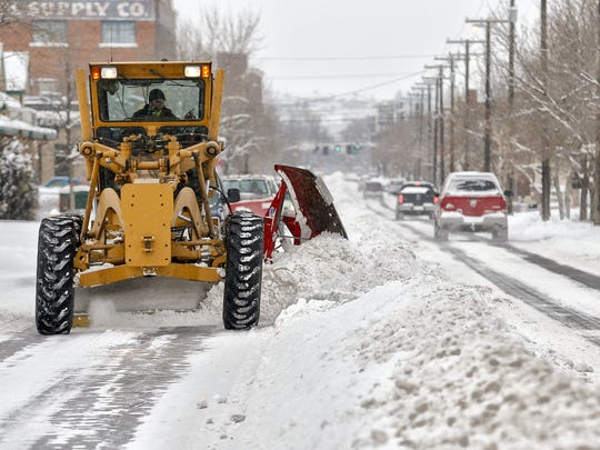 Cody Lattin with the City of Great Falls Public Works Street Division, uses a road grader to plow snow  2nd Street South.