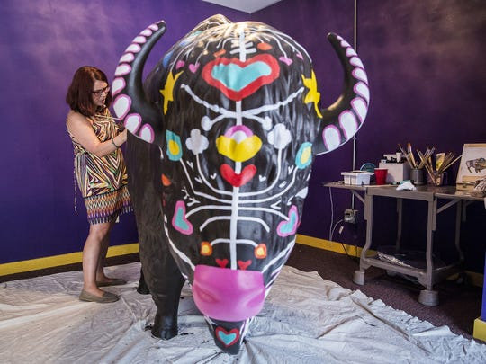 Denise King of Magic City Murals paints the Bison-tennial in downtown Muncie during First Thursday in July. The now-completed fiberglass sculpture marking Indiana's bicentennial was later installed in Tuhey Park.