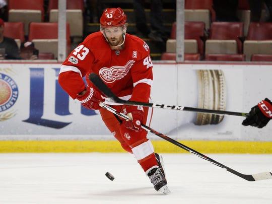 Red Wings center Darren Helm (43) skates next to a bouncing puck against the Ottawa Senators Monday at Joe Louis Arena.