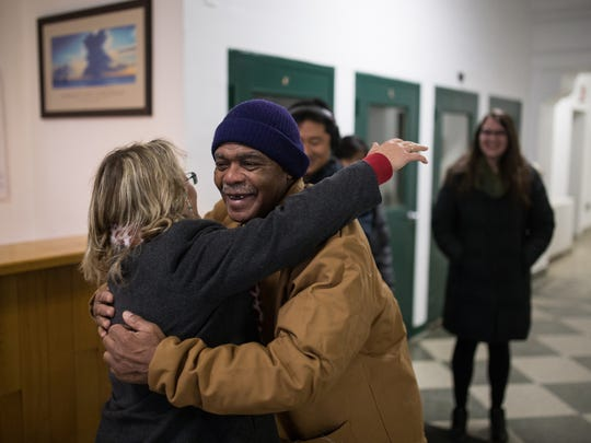 Attorney Valerie Newman, then with the Michigan State Appellate Defender Office, gets a hug from client John Sam Hall last Feb. 2, as he is released from prison after serving 50 years for murder.  Newman will head the newly formed conviction integrity unit  in the Wayne County Prosecutor's Office.