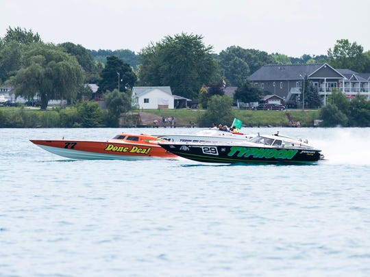 Typhoon (right) passes Done Deal during the Super Bee Lite race Sunday, July 29, 2018 during the St. Clair River Classic Offshore Powerboat races.