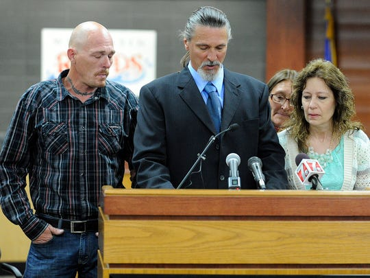 James Meister, center, brother of Dale Meister, reads a statement from the Meister family Friday May 24, 2013, at a press conference.