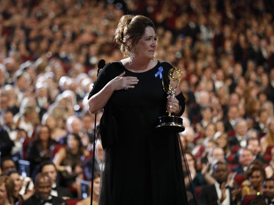 Ann Dowd accepts the award for outstanding supporting
