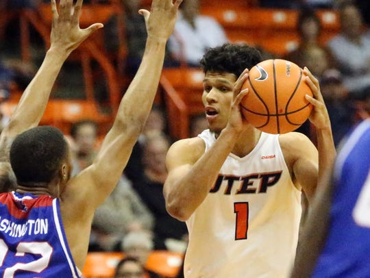 UTEP's Paul Thomas, 1, tries working the ball inside