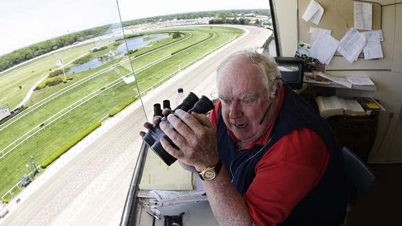 """In this May 26, 2008, file photo, Belmont Park track announcer Tom Durkin looks down at the homestretch while calling the first hose race of the day at Belmont Park in New York. After two decades or so as the signature voice for the sport's premier events, but more sleepless nights and anxious moments than he could bear, Durkin simply said, """"enough."""""""