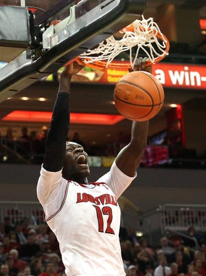 U of L's Mangok Mathiang dunks in the first half while facing off against Houston at the KFC Yum! Center in Louisville. Jan. 16, 2014.