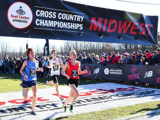 Memorial senior Matthew Schadler (middle) finished eighth at the Midwest Regional on Nov. 28 in Wisconsin.