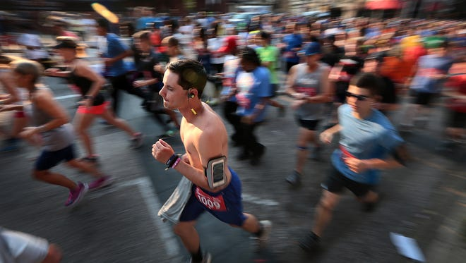 Runners begin the 15th annual Chick-fil-A 5K downtown in front of Autozone Park.