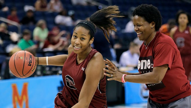 South Carolina center Alaina Coates (41) drives to the basket during a practice session for the NCAA Final Four tournament women's college basketball semifinal game, Saturday, April 4, 2015, in Tampa, Fla. South Carolina plays Notre Dame Saturday in a semifinal game. (AP Photo/Chris O'Meara)