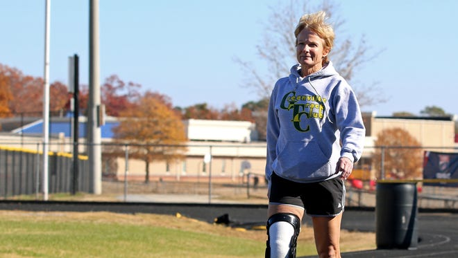 Marie Strong walks around the track at Eastside High School on Saturday November 26, 2016 as part of an exercise routine to prepare for the Greenville News Run Downtown.