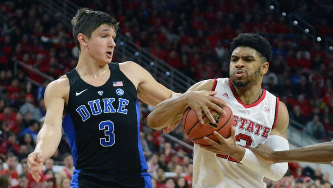 North Carolina State guard Allerick Freeman drives to the basket as Duke guard Grayson Allen, left, defends during the first half at PNC Arena in Raleigh, N.C.