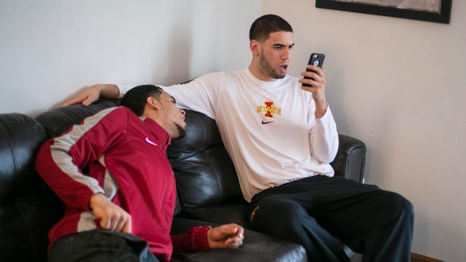 """A friendly argument with a new technology twist can be found between roomates Naz Long, left, and Georges Niang, right. """"(Naz) thinks he can sing,"""" Niang said. """"There will be songs that come out, and he'll make up his own versions. I remember one time he put it on Snapchat, and someone sent him a snap back and said he could really sing.""""Long then looked toward Niang, seated next to him on the couch: """"See, I told you I could sing."""""""