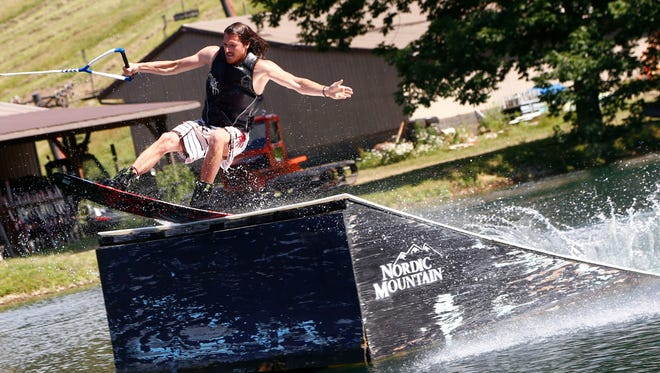 Luke Power tests out a ramp while wakeboarding at Clear Fork Adventure Resort in Butler on Thursday. The resort is located on a former skiing slope and will have its grand opening on Saturday.