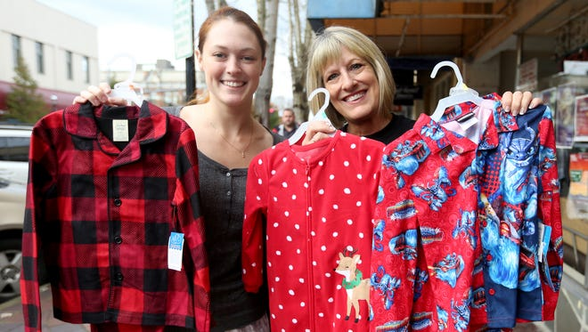 Jaimie Enloe, left, with Epic Fitness, and LaDonna Smith, with the United Way, invite people to donate pajamas for local foster children at various drop sites in Salem.