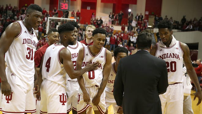 The Indiana Hoosiers wait for head coach Tom Crean to leave the court with them after defeating the North Carolina Tar Heels at Assembly Hall, Bloomington, Ind., Wednesday, Nov. 30, 2016.