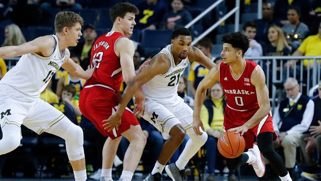 Jan 14, 2017; Ann Arbor, MI, USA; Nebraska Cornhuskers guard Tai Webster dribbles while defended by Michigan Wolverines guard Zak Irvin (21) in the first half at Crisler Center.
