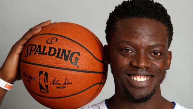 Pistons point Reggie Jackson poses during media day at the Palace of Auburn Hills on Sept. 25, 2017.
