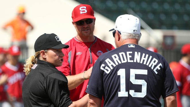 Tigers manager Ron Gardenhire, home plate umpire Jen Pawol and Florida Southern coach Lance Niekro meet before playing the exhibition opener Thursday in Lakeland, Fla.