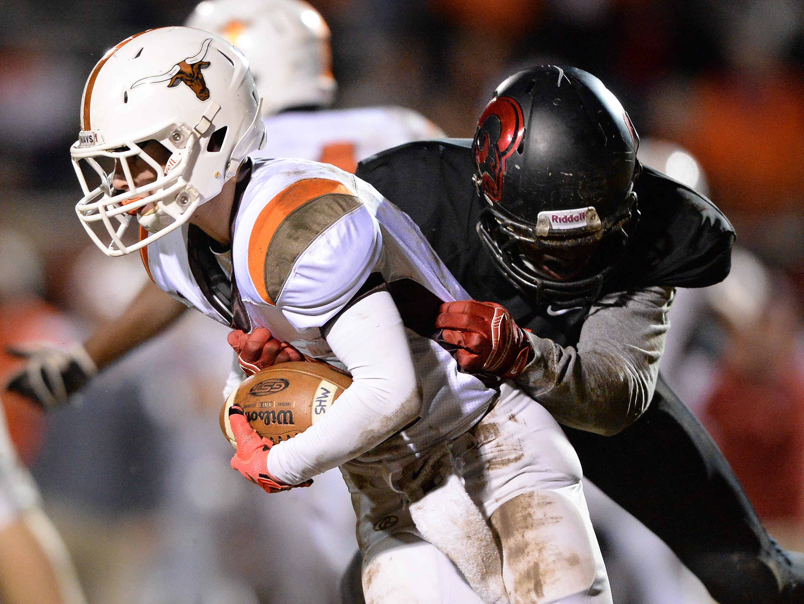 Hillcrest's Tori Delesline (4) sacks Mauldin quarterback Mitch Norman (11) during the first round of the Class AAAA Division-I playoffs Friday, November 20, 2015 at Hillcrest High.