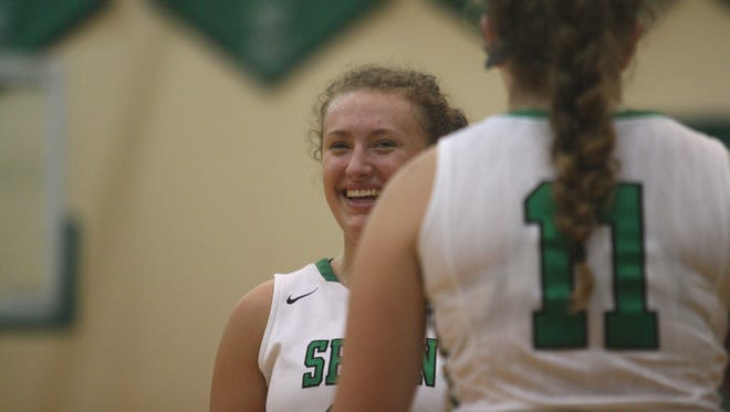 Seton senior Bridgette Grote laughs with a teammate during a timeout in a game against Anderson on Thursday, Jan. 11, 2018.