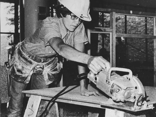 """This photo from 1974 shows Dale McCormick, the first woman in Iowa to apprentice in carpentry and become a journeywoman. McCormick -- who wrote the book, """"Against the Grain"""" -- will be participating this weekend in the Iowa City Feminist Reunion."""