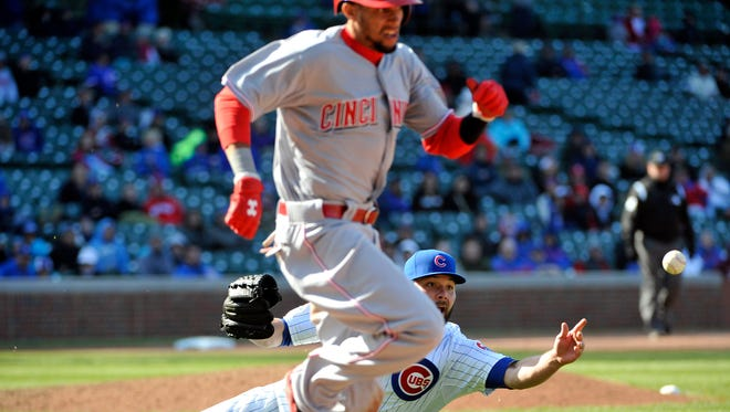 Cubs relief pitcher James Russell throws out Reds center fielder Billy Hamilton at first base during the ninth inning Friday at Wrigley Field.