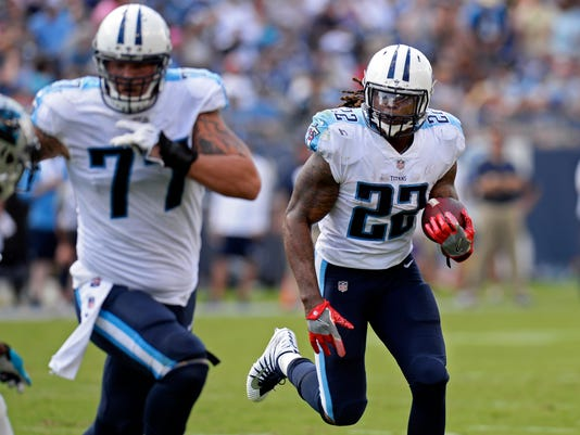 Tennessee Titans running back Derrick Henry (22) follows the blocking of tackle Taylor Lewan (77) against the Carolina Panthers in the first half of an NFL football preseason game, Saturday, Aug. 19, 2017, in Nashville, Tenn. (AP Photo/Mark Zaleski)