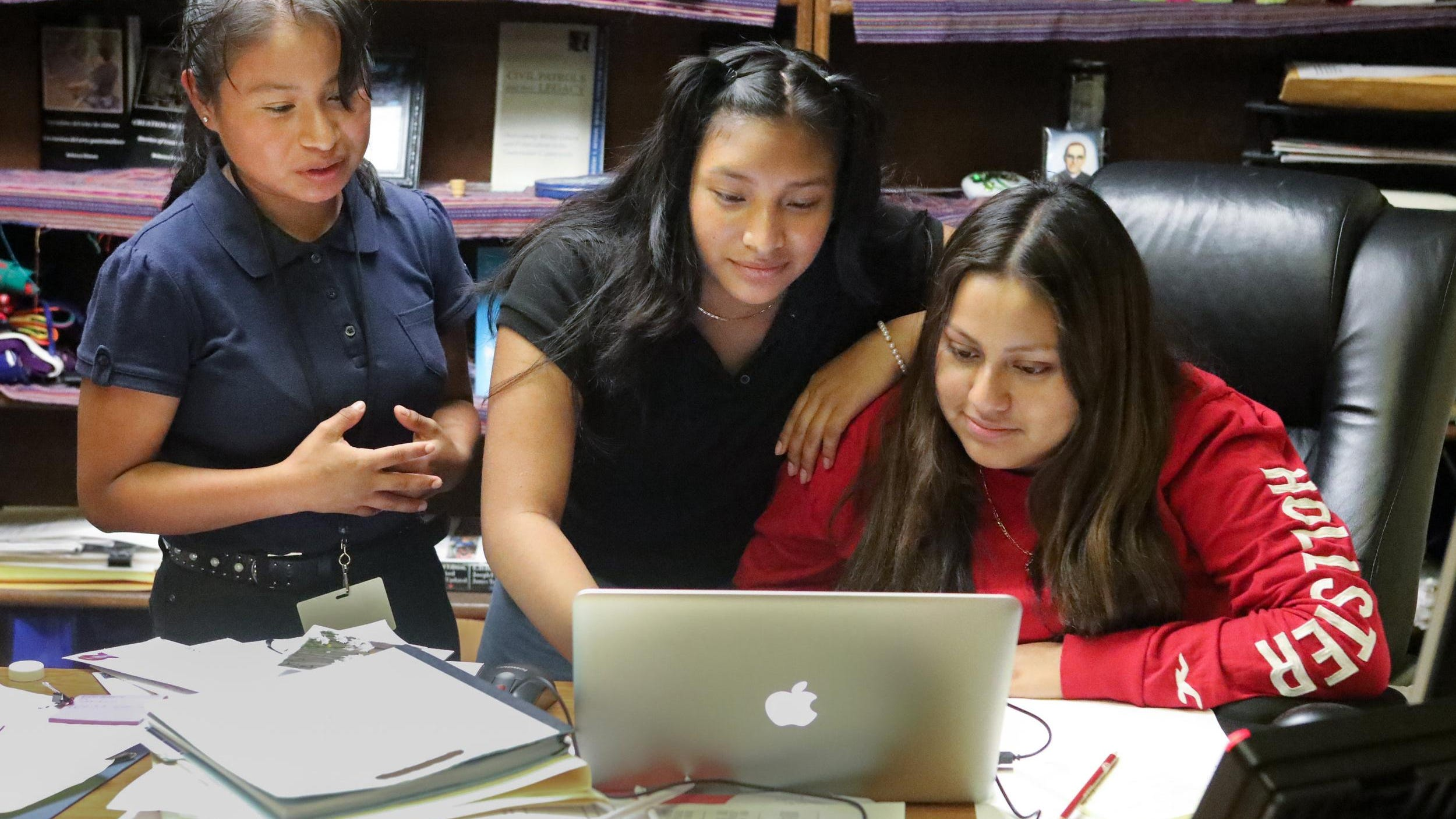 The Mayan Girls (from left) Yury Aracely Lopez Perez, 17, Madgalena Francisco, 16, and Lorena Felipe Sebastian, 17, translate a community center document into the indigenous language Akateco, Thursday, September 26, 2019.