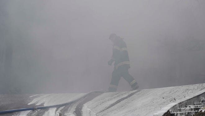 Firefighters work the scene at a Tuesday morning house fire that destroyed a home on Fleetwood Drive in West Nashville.