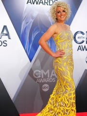 Country singer Cam arrives on the red carpet at the