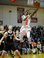 Bosse's Mekhi Lairy (2) shoots past Boonville's Glen Rouch (5) during their game at Bosse High School in Evansville, Friday, Jan. 20, 2017. Bosse beat Boonville 101-51.