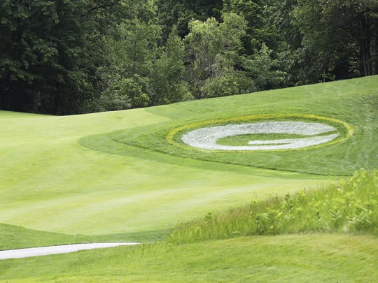 The Green Bay Packers logo is painted next to the fairway on the first hole at Thornberry Creek at Oneida golf course in preparation for the LPGA Classic tournament in July..
