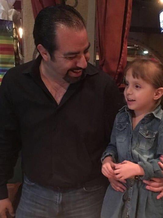 Adrian Reza and his daughter Regina, 4, of Rockledge.