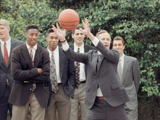 The college basketball national champion Duke Blue Devils were honored by U.S. President George H. Bush on April 22, 1991 in Washington at the White House. From left watching Bush show off his ball handling are Brian Davis, Thomas Hill, Crawford Palmer and tennis star Ivan Lendl, an overnight guest at the White House.
