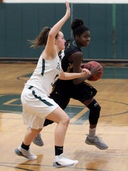 Pleasantville's Jenna McAllister guards hastings Melanie Daley during their Section 1 Class B first round game at Pleasantville Feb. 15, 2018. Hastings won 64-52.