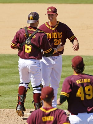 Arizona State catcher Brian Serven (6) greets  pitcher Brett Lilek (26) after he threw a complete game in their win over UCLA Saturday, May 10,  2015 in Tempe, Ariz.