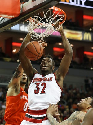 U of L's Chinanu Onuaku, #32, dunks against Syracuse during their game at the KFC Yum! Center.Feb. 17, 2016
