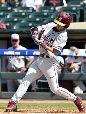 Florida State's Matt Henderson makes contact with a pitch against Louisville during the ACC baseball tournament in Louisville, Ky. on Friday.