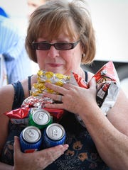 Karen Wallace, Evansville, gathers up food for the