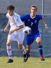 Mater Dei's Zach Schoenstein (11) and Memorial's Samuel Hodge (7) chase down the ball in Memorial territory during the Class 2A Sectional boys soccer final.