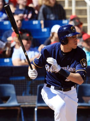 Christian Yelich keeps his eye on the ball as he heads to first after singling against the Indians on Sunday.