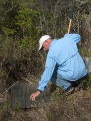 Rick O'Connor of Florida Sea Grant checks a trap as