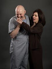 "Scott Schmelder as Hannibal Lecter and Brandi Bigley as Clarice in Stray Cat Theatre's ""Silence! The Musical."""