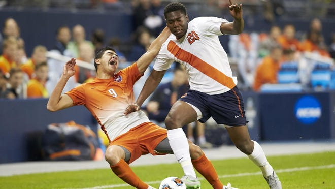 Clemson forward Diego Campos, left, and Syracuse defender Kamal Miller battle for the ball in NCAA Final Four on Friday.