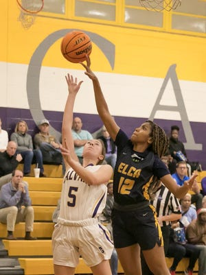 Calvary Day's Hannah Cail (5) has her shot tipped by Eagle's Landing Christian's Jalisa Dunlap in a playoff game last season at Calvary.