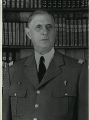 General Charles de Gaulle photographed in uniform against a library background in Paris, April 1960.