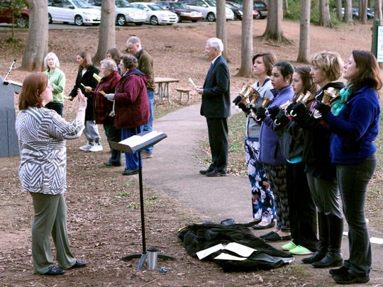 Mandy Keathley, music director for Central Presbyterian Church of Anderson, leads a handbell group during the 2015 Easter Sunday sunrise service at Cater Lake Park.